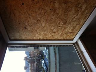 Smashed window boarded Newcastle upon Tyne